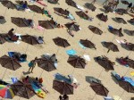 beach-parasols-with-people